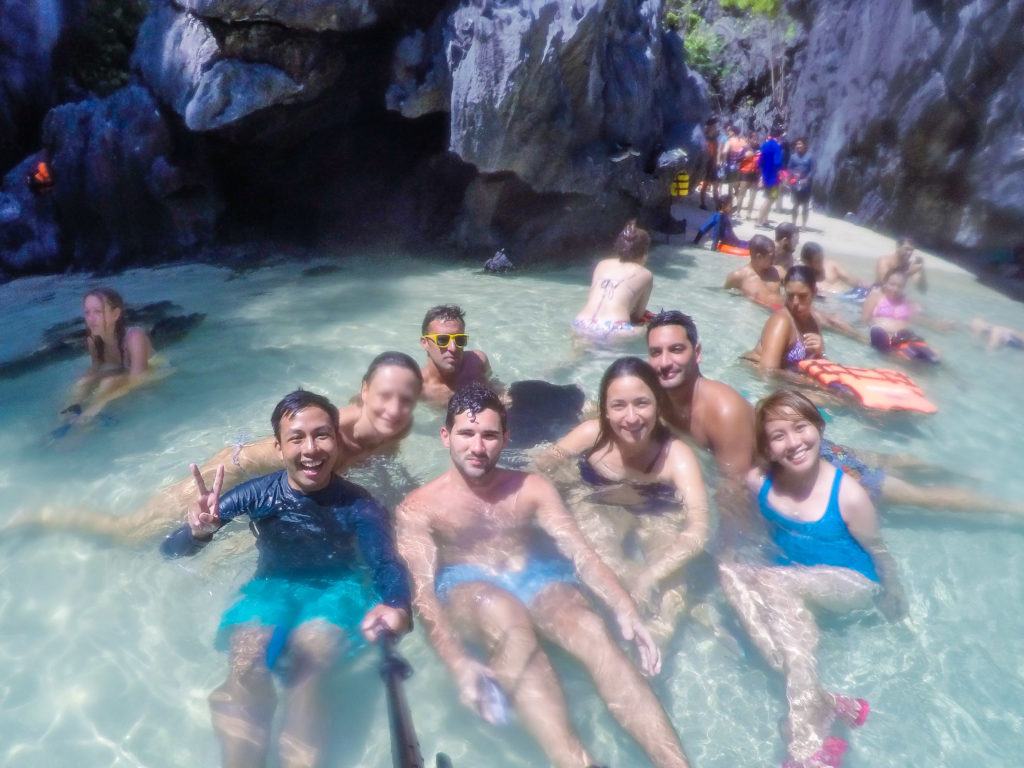 foreign tourists italian french american in secret beach el nido palawan