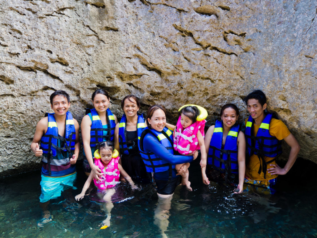 family swimming picture in minalungao national park nueva ecija