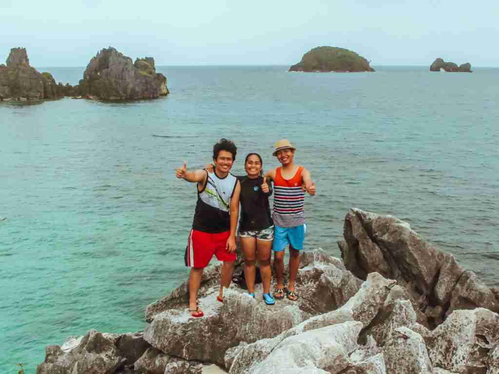 rock climbing in the rock formation of matukad island in caramoan