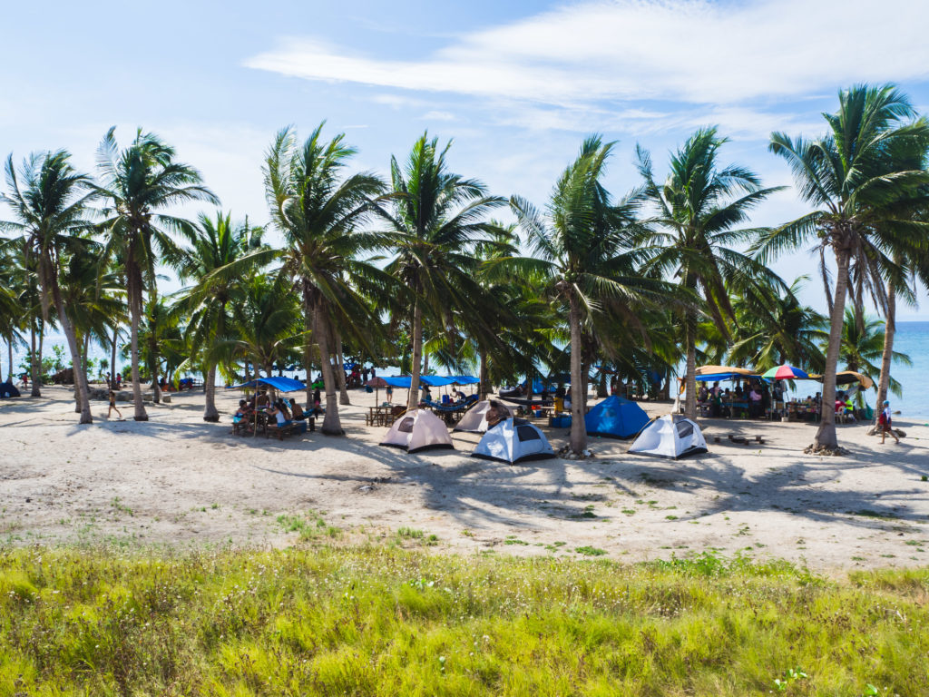 tent pitching under coconut trees in tinalisayan island masbate