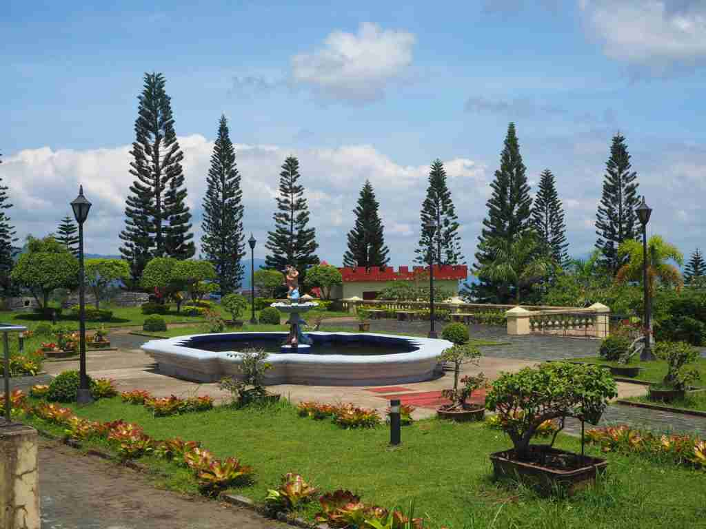 pine trees and water fountain fantasy world in lemery batangas