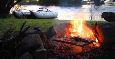Relaxing by a riverside fire