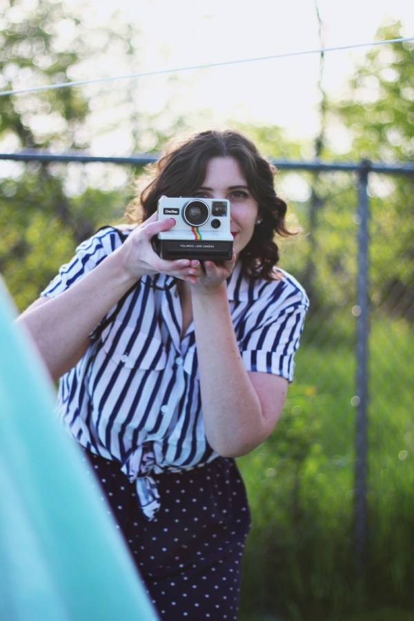 Outfit mixing striped shirt and polka dotted shorts. Sunny outdoor photos with a bed sheet and Polaroid camera!