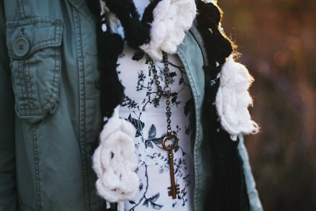 outfit details: key necklace, black and white floral dress, utility jacket, crochet flowered scarf