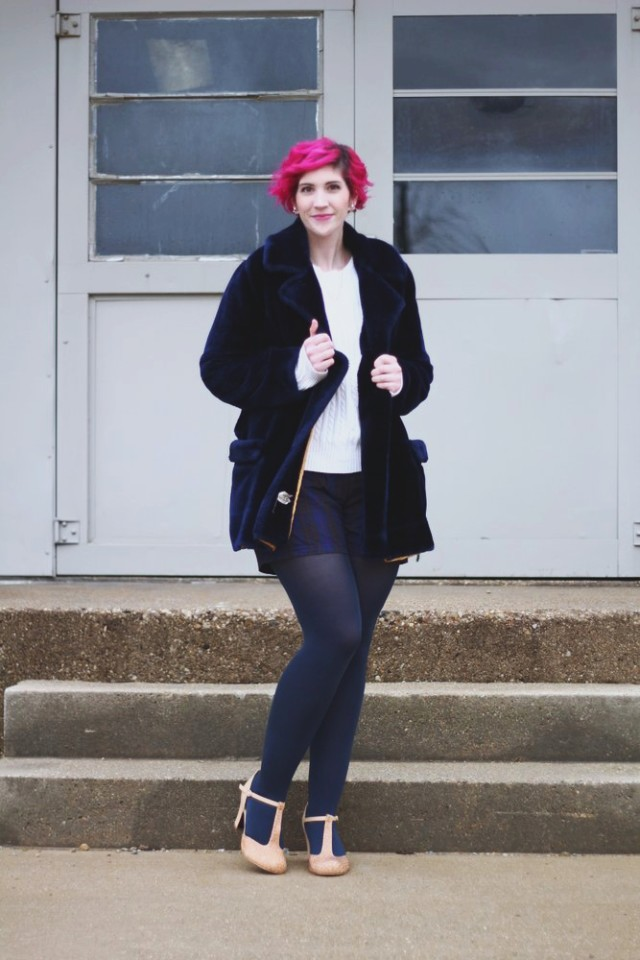 Outfit: furry blue coat, oversized white sweater, high waisted plaid shorts, navy blue tights, beige t-strap high heels, curly pink hair