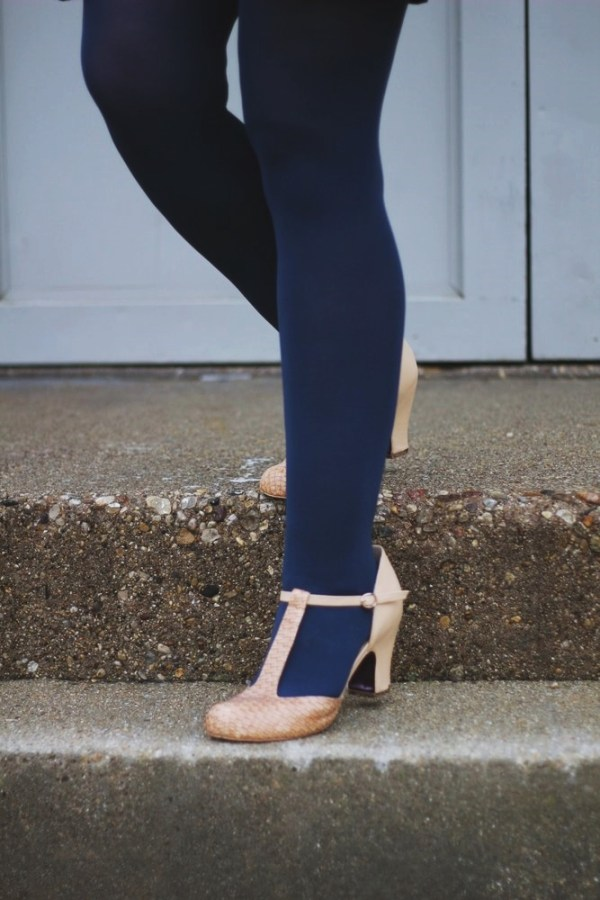 Outfit details: navy blue tights and beige t-strap high heels