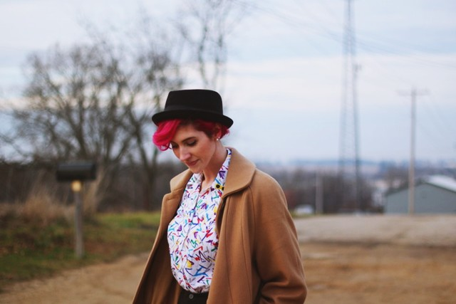 Outfit: colorful printed shirt, high waisted shorts, purple tights, pork pie hat, pink hair, black flats, vintage camel colored coat