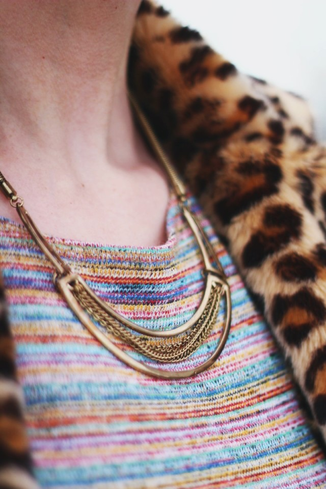 Outfit details: gold statement necklace, striped crop top, leopard print coat
