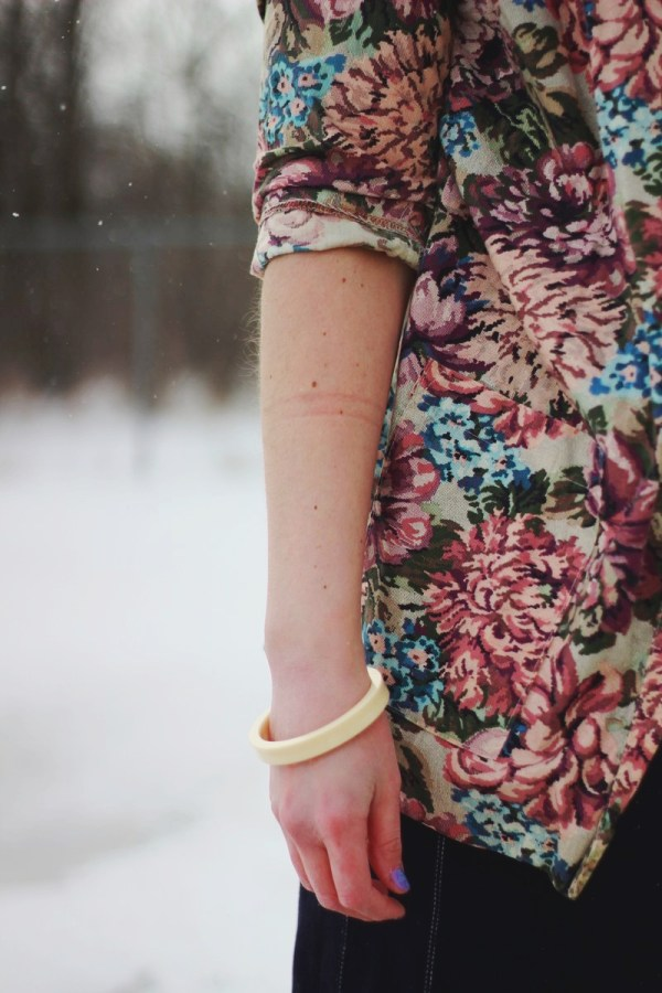 Pretty In Pink inspired volcanic ensemble: thrifted floral blazer, cream colored 1980s bangle
