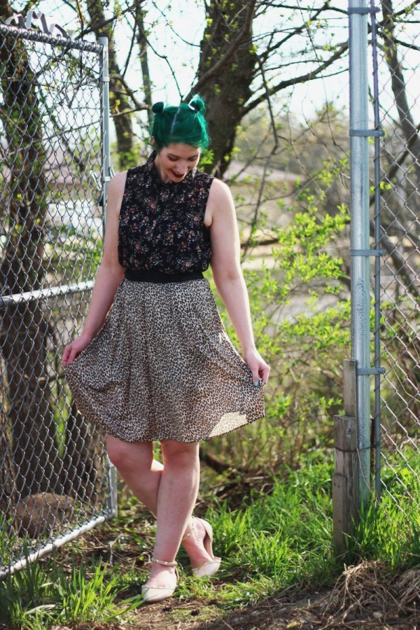 Anti-spring outfit: floral sleeveless button up, leopard print skirt, round sunglasses, green hair, studded nude flats