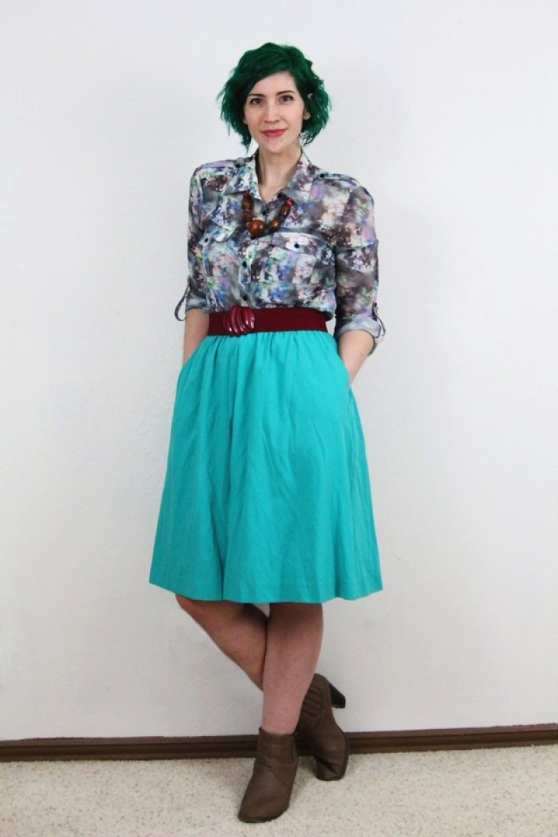Spring outfit: teal skirt, printed top, maroon belt, chunky necklace, pine green hair, tan booties