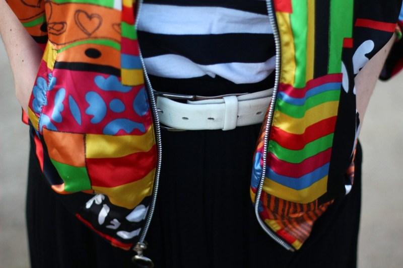 Outfit details: striped shirt, colorful bomber jacket, wide wide belt, black skirt