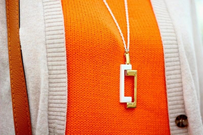 Vintage orange top, beige cardigan, retro gold and white necklace