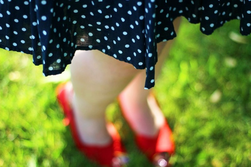 Outfit details: navy blue polka dotted skirt, vintage red kitten heels