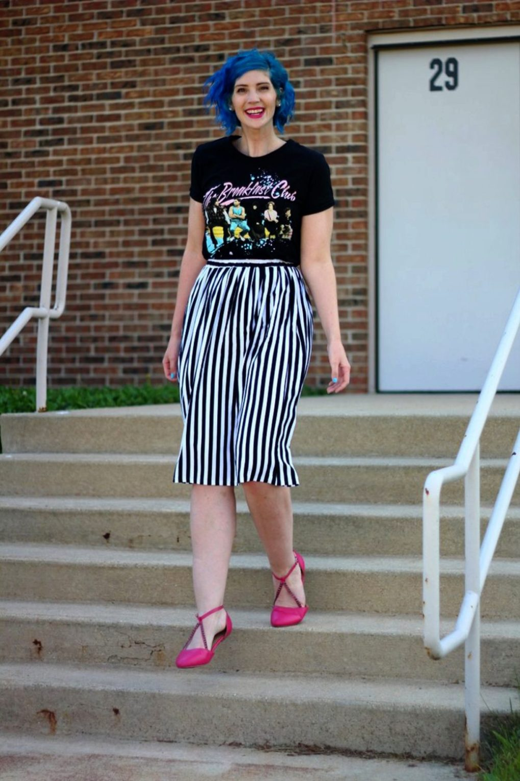Outfit: Breakfast club graphic tee, black and white striped skirt, blue hair, pink lipstick, pink flats.