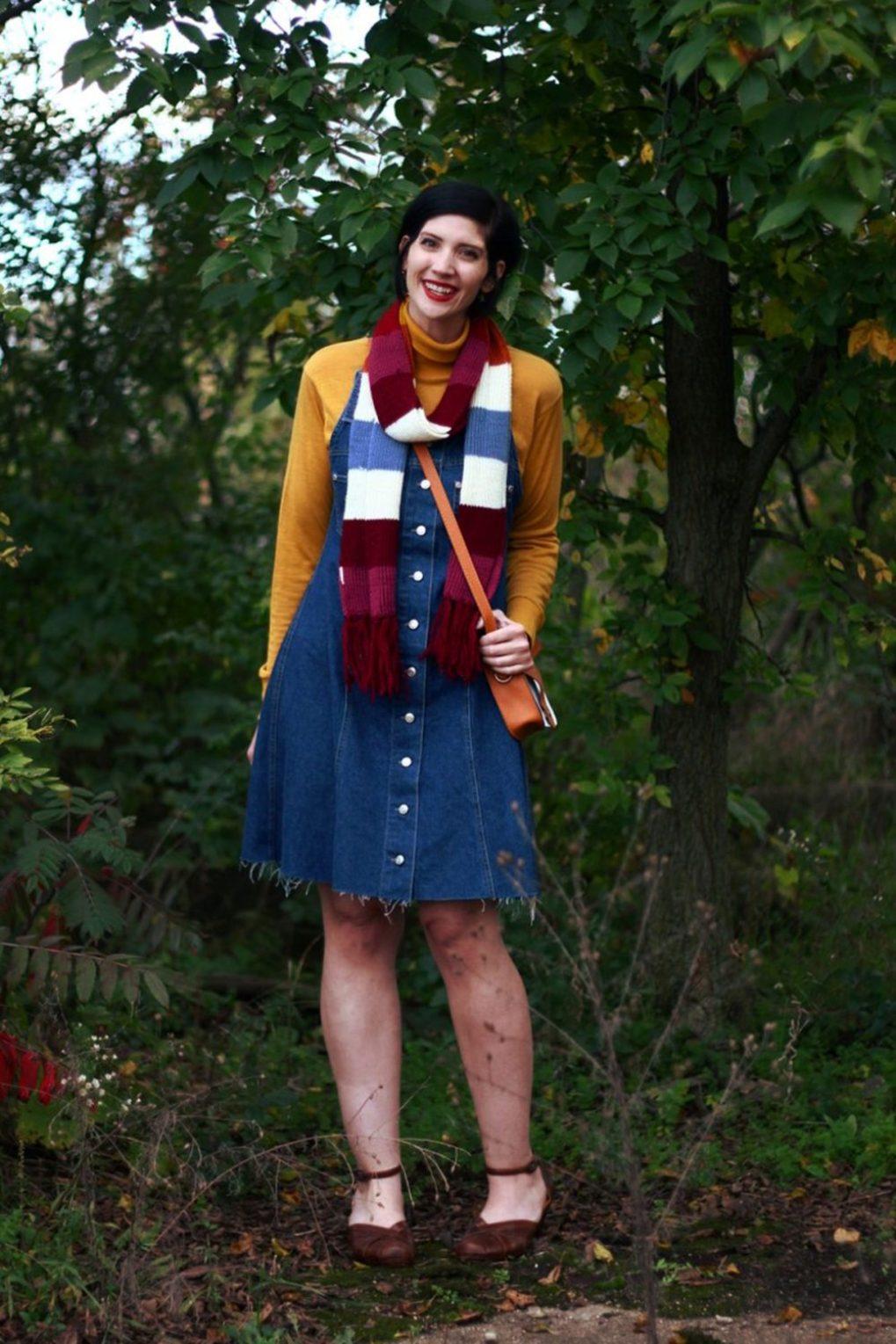 Outfit: Mustard yellow turtleneck, denim overall dress, multi-colored striped scarf, red lipstick, orange fox handbag, brown platforms