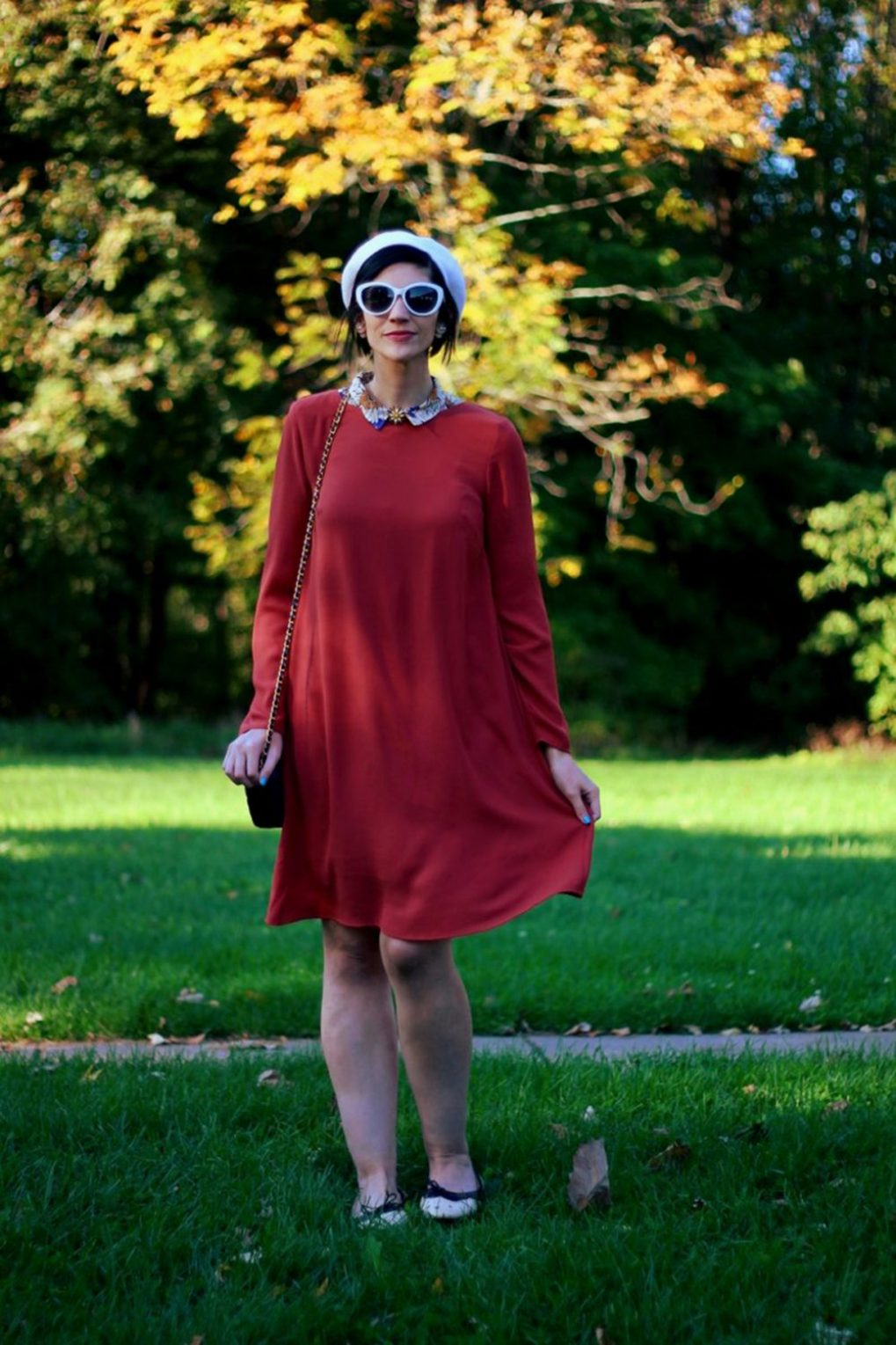 Outfit: Orange retro style dress, flower collar, jewel flower brooch, cream colored beret, navy purse, brown flats