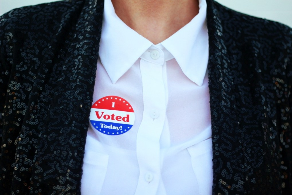 Election day outfit: white button up, I Voted sticker, black sequined blazer,