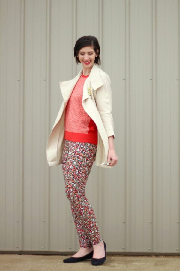 pattern mixing, orange sweater, floral pants, 1980s trench coat, vintage style, outfit