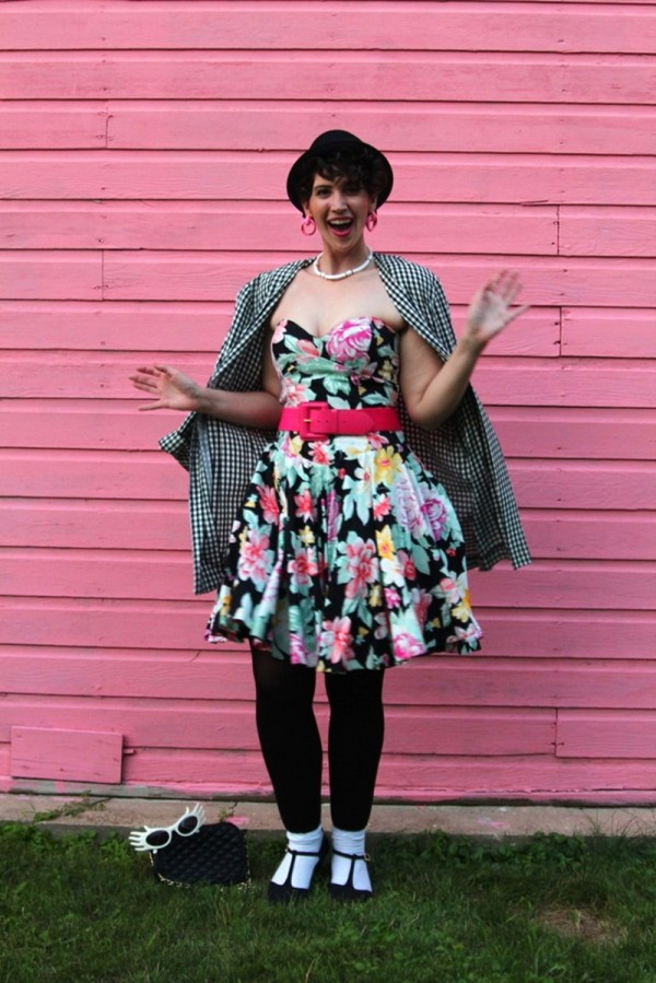80s style floral prom dress, footless tights, pink belt, gingham jacket, pork pie hat, doorknocker earrings, quilted purse, white sunglasses, socks with heels