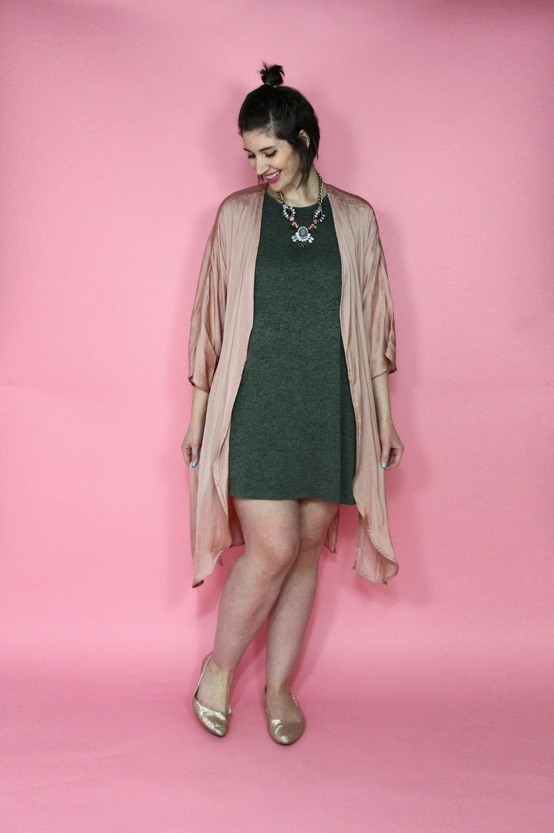 valentine's day outfit hannah rupp wears a green dress, pink kimono, and statement necklace