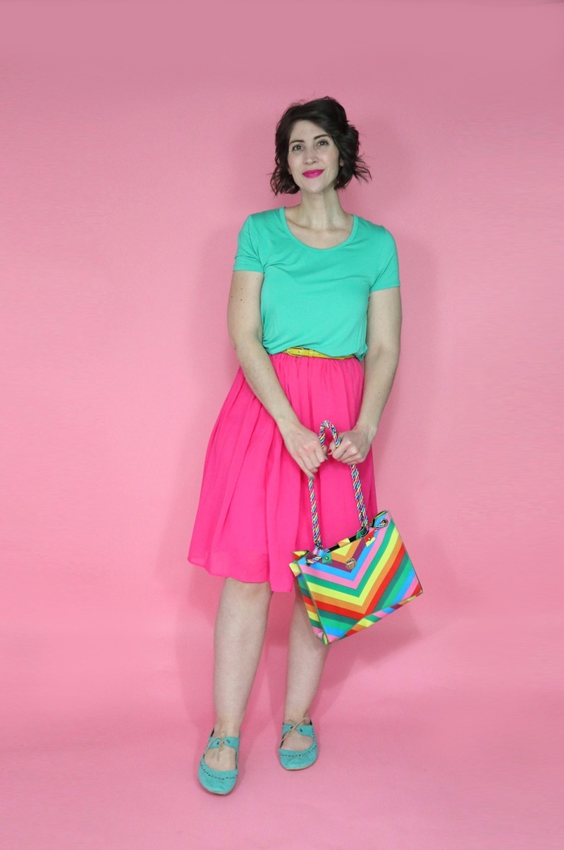 best thrifted clothes outfit teal tee pink skirt rainbow purse