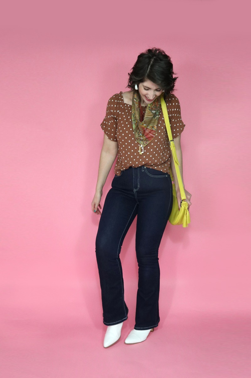 best thrifted clothes high waisted dark wash flared jeans polka dot top yellow purse outfit