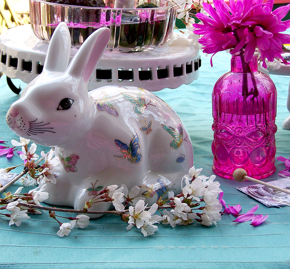 Easter bunny table tablescape figurines figures glass cut pink white flowers cherry blossoms blooms tea hony dippers butterflies old fasjioned bunnies bunny rabbit rabbits Easter facts funny interesting kids tea party marimo balls moss algae decoration decor home