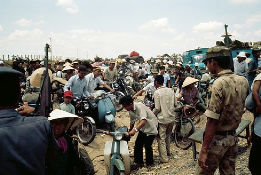 Refugees in Thailand on motorcycles in a detention facility after fleeing the Khmer Rouge Regime in Cambodia. In June 1978, Martin was assigned to the United Nations High Commissioner for Refugees (UNHCR) Regional Office in Bangkok.