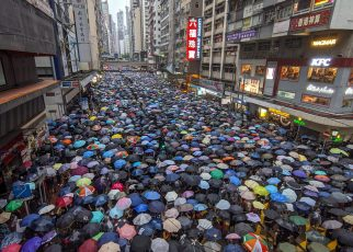 Protests in streets of Hong Kong where protesters hold umbrellas