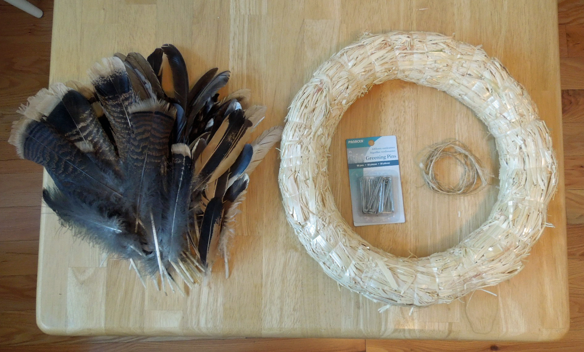 Diy feather thanksgiving wreath tutorial for Where can i buy feathers for crafts