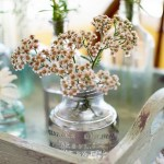 A Simple Centerpiece Idea Using Vintage Bottles And Flowers