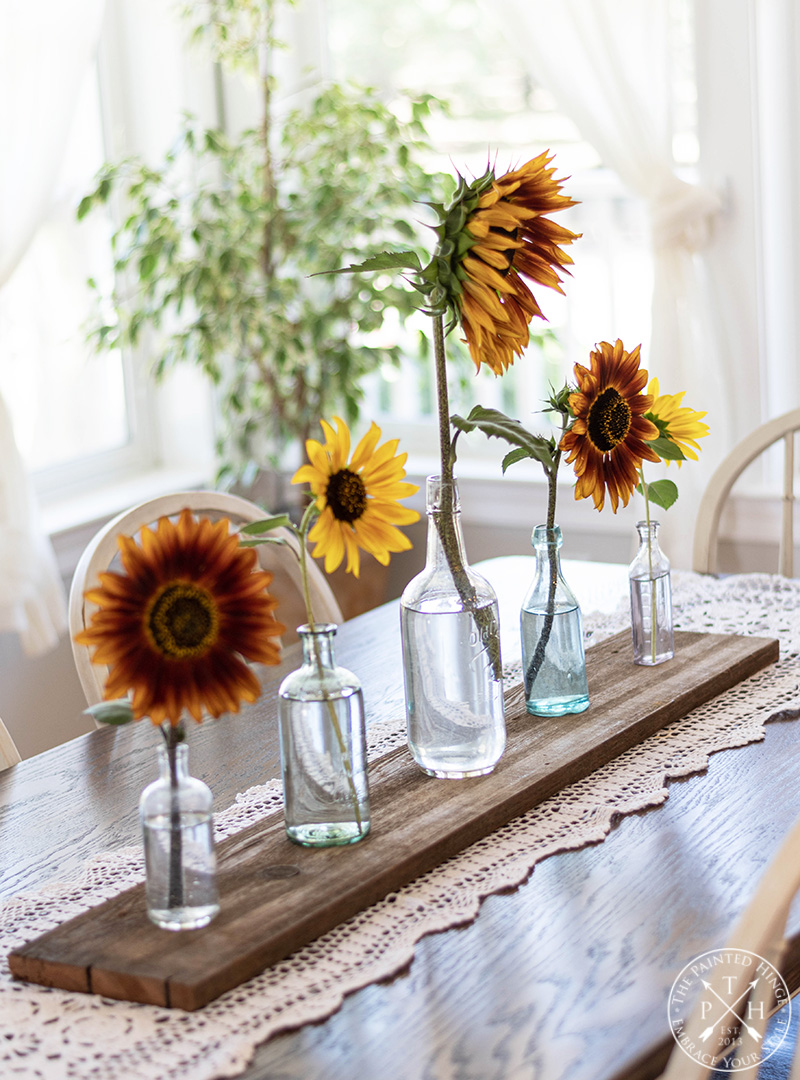 Easy Sunflower Centerpiece with Vintage Bottles