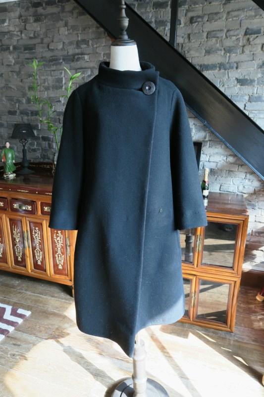 Vintage black 1950s bell shaped Christian Dior coat front