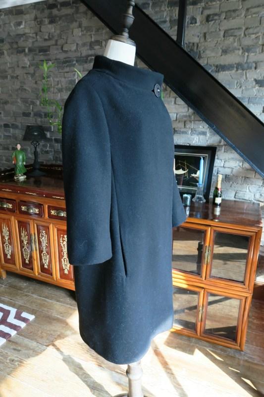 Vintage black 1950s bell shaped Christian Dior coat side