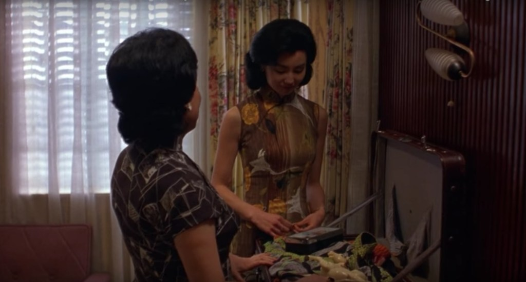 """Obsessed with """"In the Mood for Love""""? The brown with white and yellow print qipao (cheongsam) from the complete list of 20 qipaos from the film. Click the link for more -"""