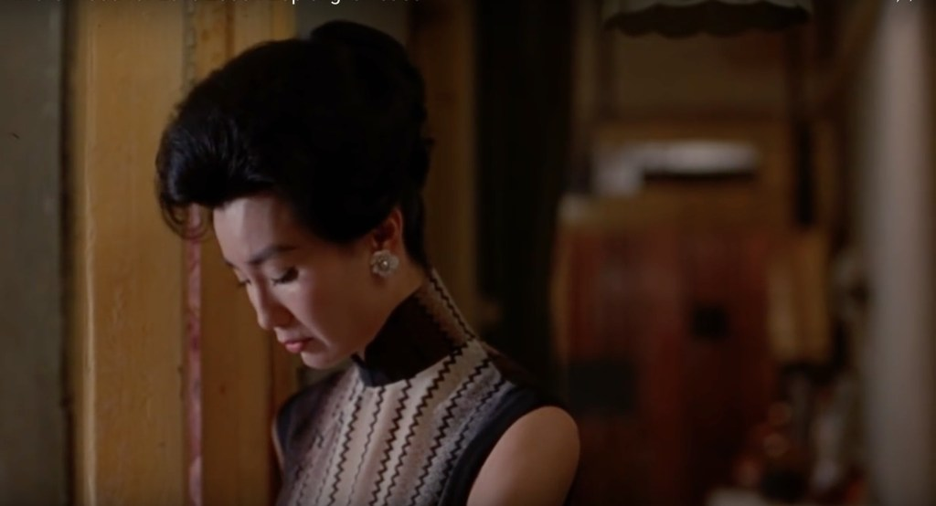 """Obsessed with """"In the Mood for Love""""? The black and white vertical striped qipao (cheongsam) from the complete list of 20 qipaos from the film. Click the link for more -"""