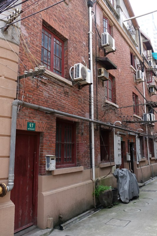 Red brick walls of Old Shanghai lane house apartment