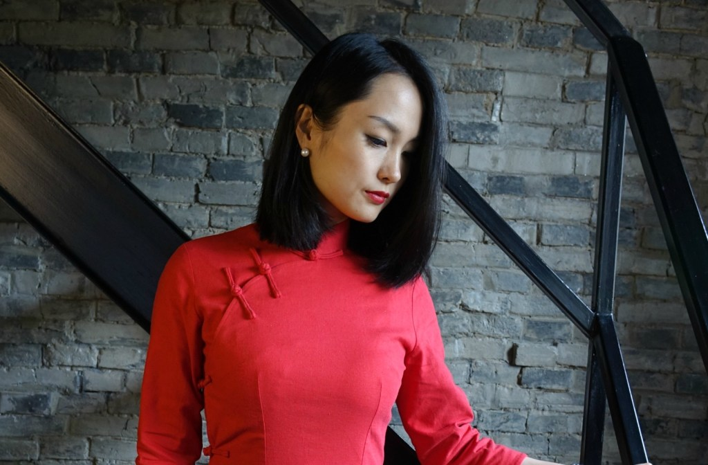 Traditional red qipao cheongsam top half view against staircase