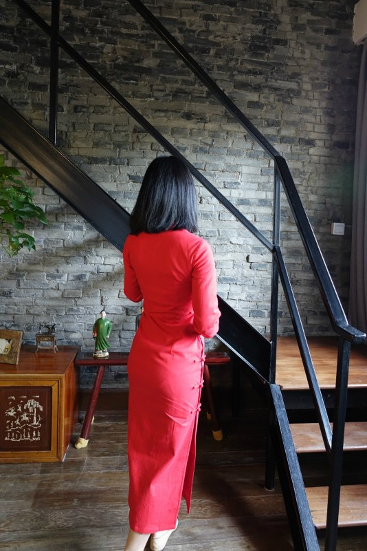 Wearing my traditional red qipao cheongsam with chanel flats - back view