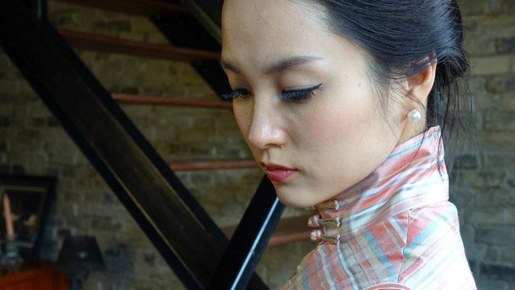 Wearing pink striped sleeveless qipao headshot