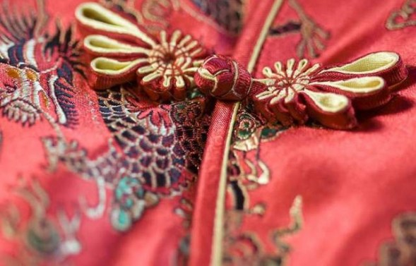 Red brocade qipao with edging and pankou details