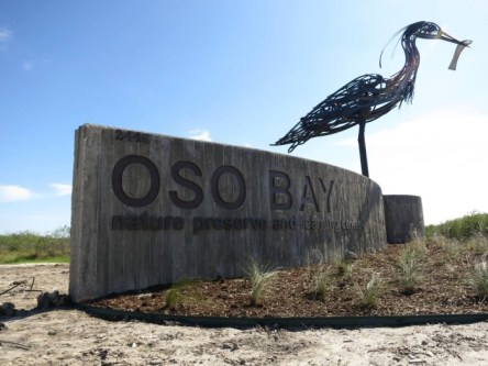Entrance-Sign-and-Great-Heron-Sculpture-Oso-Bay--700x525