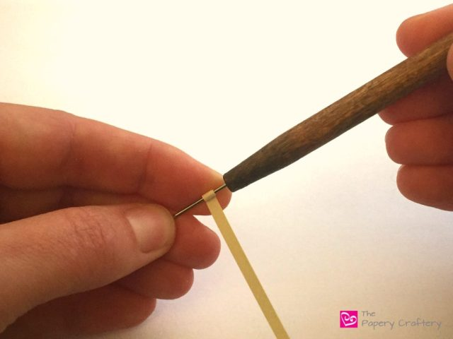 Rolling quilling paper on a needle tool. Needle tools and slotted tools: Which quilling tool is right for you? || www.thepaperycraftery.com