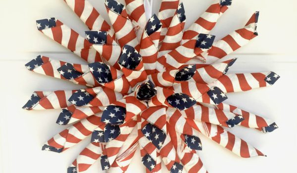 Patriotic Paper Wreath ~ Grab some flag napkins to whip up this red, white and blue stunner that can dress up your front door all summer long!    www.thepaperycraftery.com