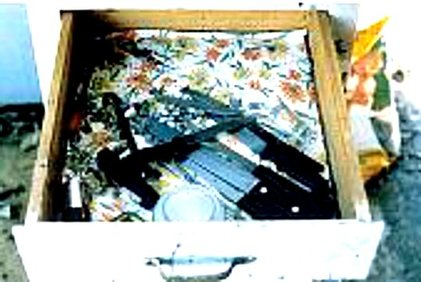 Hurled objects were collected in this drawer, many of them knives.