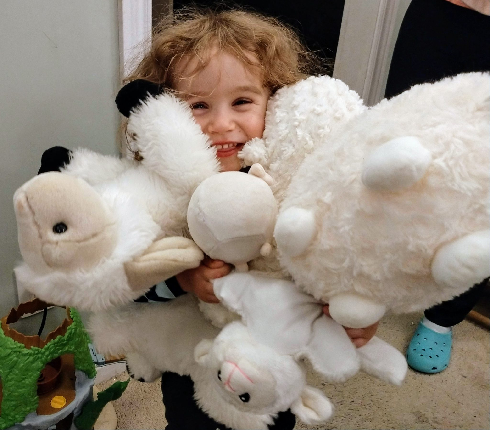 Sophie with Stuffed Animals Lambs