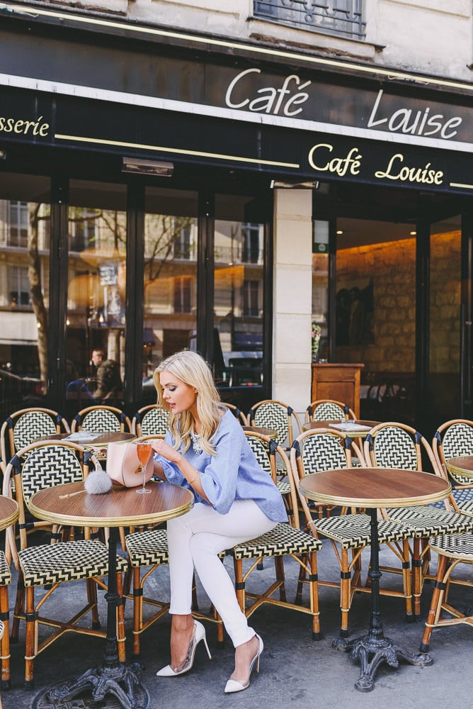 Blond fashionista sitting at Cafe Louise with Chloe purse