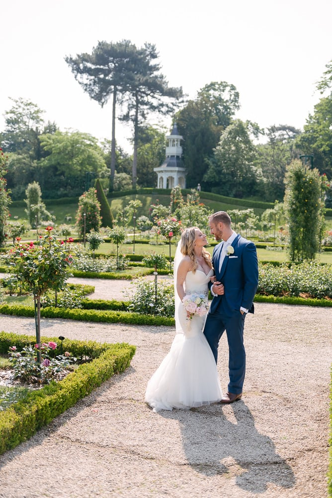 Bride and groom walking after they said yes to each other in the Jardins de Bagatelle in Paris