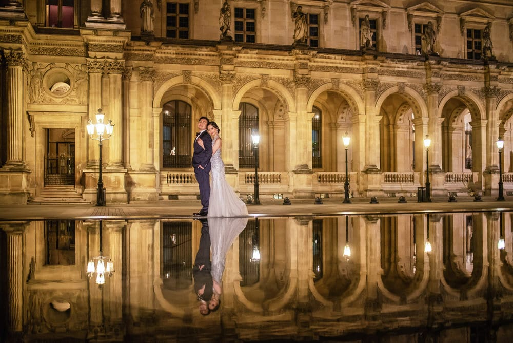 Paris pre wedding photography at night by the Louvre Museum
